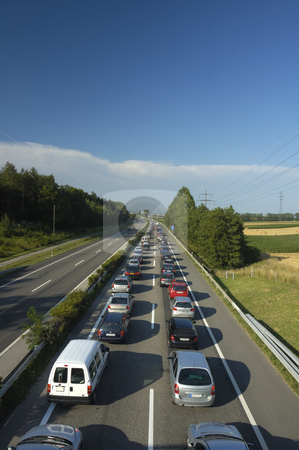 Traffic Jam stock photo, A line of stationary traffic stretches away into the distance on one side of the freeway (motorway, autoroute, autobahn) whilst, in the other direction it is completely clear. by Alistair Scott