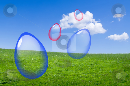 Easter stock photo, Easter glass eggs in a green meadow against a blue sky. by Serge VILLA