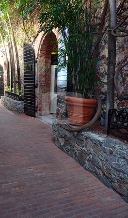 Shady cobblestone backstreet stock photo, A cool shady cobblestone backstreet by Jill Reid