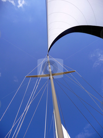 Wind in the mainsail on a bright blue sky stock photo, View of the wind in the mainsail and sailboat mast on bright blue sunny day by Jill Reid