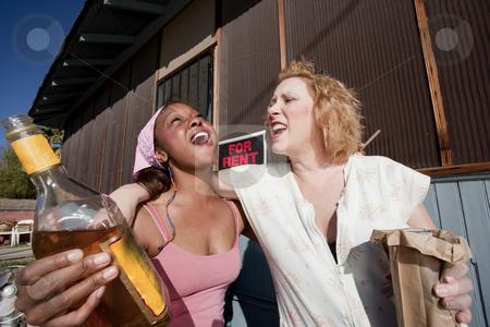 Drunk Women stock photo, Portrait of two trashy drunk women outdoors by Scott Griessel