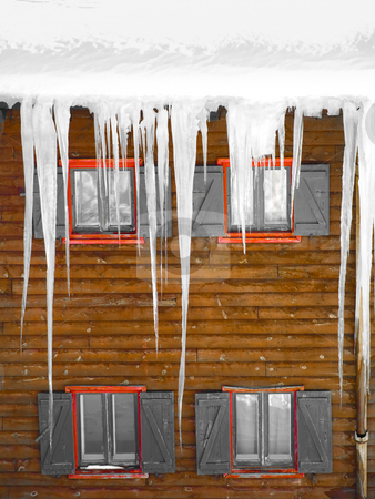 Wooden windows with  ice stalactites stock photo, Wooden windows with  stalactites of ice by Laurent Dambies