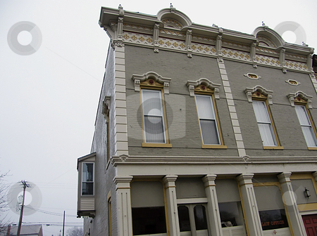 Ornate Building Trim stock photo, Decorative / Ornate Building Trim around the roof and windows on this old vintage building I had seen on my way into Columbus coming from Mechanicsburg Ohio. I think this was in Mehcanicsburg Ohio, but not for sure. by Dazz Lee Photography