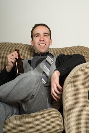 Relaxed Business Portrait stock photo, A relaxed businessman is enjoying his bottle of beer by Richard Nelson