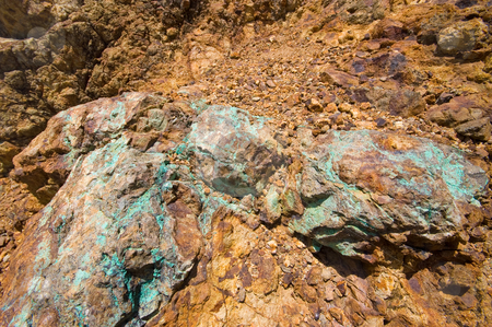 Piece of a copper vein stock photo, Piece of a green copper vein in the rocks by Karin Claus