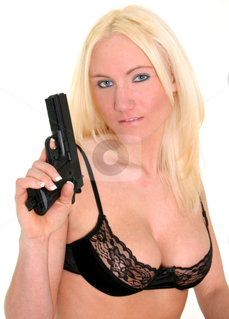 Prepared stock photo, Blond ready with her gun by Gregg Cerenzio