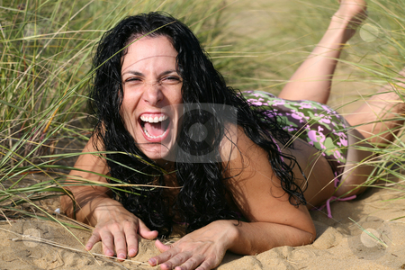 Girl In Bikini Laughing At The Beach In Tall Grass and Sand stock photo, Girl In Bikini Laughing At The Beach In Tall Grass and Sand by Gregg Cerenzio