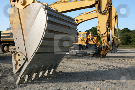 Construction Lineup With Close BackHoe stock photo, Lineup of Construction Vehincles At Construction Site, Backhoe upfront by Gregg Cerenzio