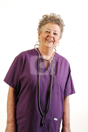 Senior nurse. stock photo, An elderly nurse in a lilac top with the stethoscope around her neck smiling in the camera. On white background. by Horst Petzold