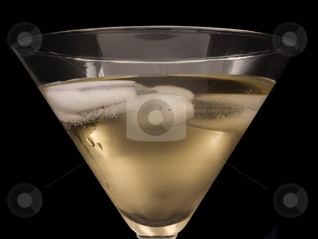 Champagne with ice stock photo, Champagne close up with ice on black background by John Teeter