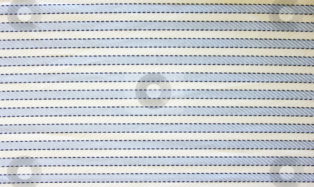 Cotton fabric stock photo, Close up of blue and white striped cotton fabric. Lit from bottom left to show depth by Martin Darley