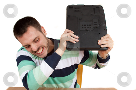 Crushing my Notebook stock photo, Man trying to smash his notebook on the table by Milan Ljubisavljevic