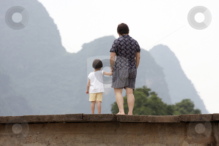 Mother and daughter stock photo, Mother and daughter on a bridge looking out in china by Christopher Meder