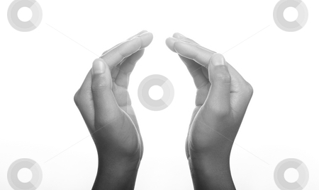 Hands clasped in religious prayer stock photo, Hands clasped in religious prayer against white background by Christopher Meder