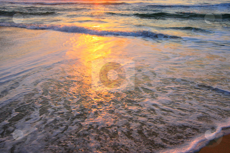 Wave Background stock photo, Serene wave background image, against a sunrise by Christopher Meder