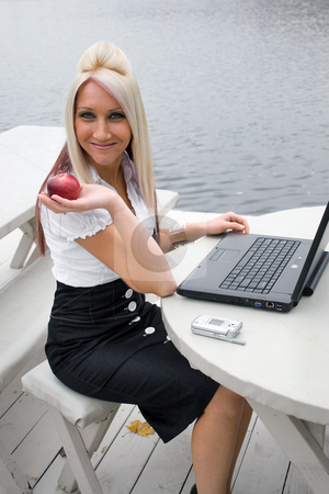 Lunch Break stock photo, A beautiful young blonde woman in a mobile business setting eating a red apple. by Todd Arena