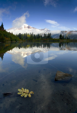 Majesty Revealed stock photo, Mt. Rainier revealing itself behind low morning clouds on a crisp autumn morning at Bench Lake by Mike Dawson