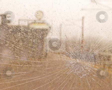 Cracked glass on a train platform stock photo, Cracked glass on a train platform by Phillip Dyhr Hobbs