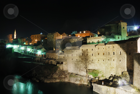 Mostar by night stock photo, Famous touristic place Mostar viewed from The Old Bridge by night. by Ivan Paunovic