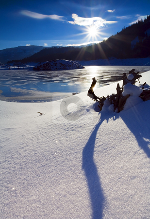 Crystal Clear stock photo, Long shadows on a cold winter morning overloooking the frozen surface of Rimrock LAke by Mike Dawson