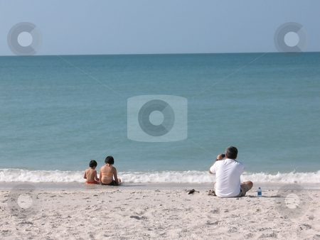 A Beautiful Day at the Beach stock photo, A family enjoying the water and sand at a Florida beach by Ray Carpenter