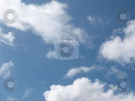 Clouds Over the Caribbean stock photo, A beautiful bright sunny day in the Caribbean, with soft white clouds moving by. by Ray Carpenter