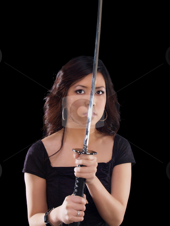 Young oriental woman with sword before face stock photo, Young asian woman holding Japanese sword in front of face by Jeff Cleveland