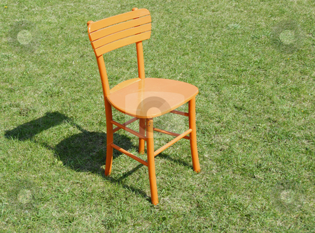 Orange wooden chair on grass stock photo, Orange wooden chair on green grass outdoor by Julija Sapic