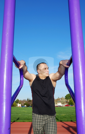Resting Between Exercises stock photo, Male athlete  resting between exercises outdoors with blue sky and white clouds in the background. by Denis Radovanovic