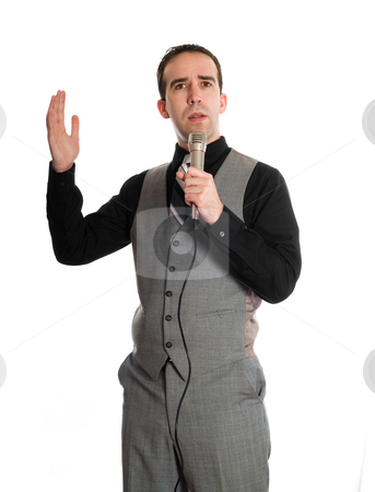 Karaoke Singer stock photo, A young businessman having a good time and singing karaoke, isolated against a white background by Richard Nelson