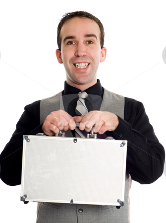 Young Businessman With Briefcase stock photo, Closeup of a young businessman holding up a metal briefcase, isolated against a white background by Richard Nelson
