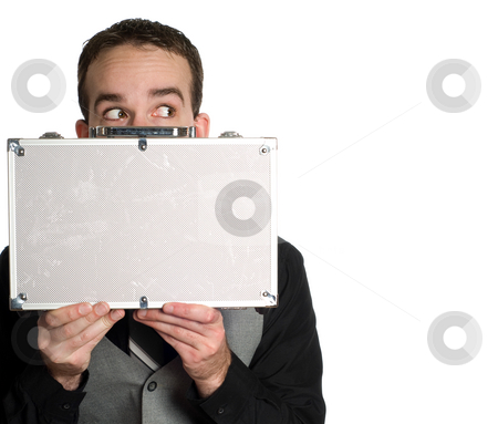 Employee Hiding stock photo, A young employee is hiding behind a small briefcase and looking out of the corner of his eye, isolated against a white background by Richard Nelson