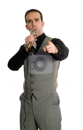 Motivational Speaker stock photo, A young motivational speaker is talking into a microphone, isolated against a white background by Richard Nelson