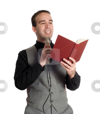 Preacher stock photo, A young preacher is reading something out of a book into a microphone, isolated against a white background by Richard Nelson