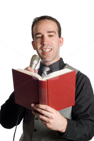 Man Reading Into Microphone stock photo, A young man reading a book into a microphone, isolated against a white background by Richard Nelson