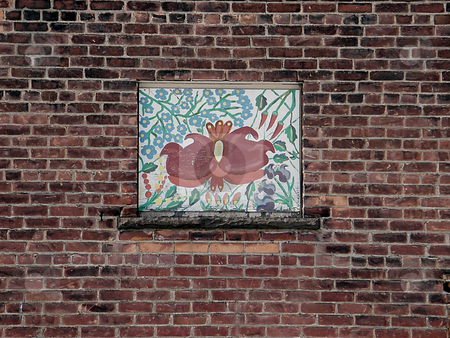 Painted Art on Boarded Window stock photo, Painted Art on a Boarded Window. Two  Birds, some tulips, and other flora painted upon the wood which covers the space in a brick wall where a window used to be. Faded colors indicate it has been around for a good while. by Dazz Lee Photography