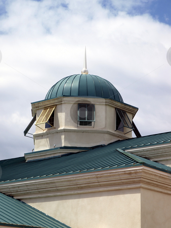 Dome with turquoise metal roof stock photo, View of a domed building with turquoise metal roof against a cloudy sky by Jill Reid