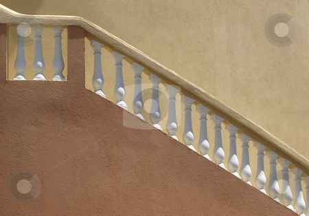 Plaster balistrade railing and stucco wall stock photo, Warm colors on a stucco building with white balistrade staircase railing by Jill Reid