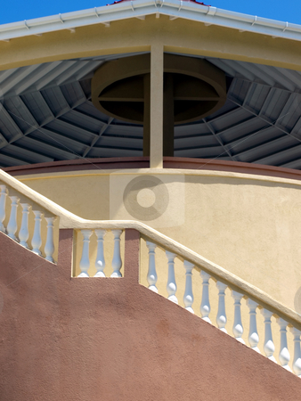 Stucco building and pavilion with staircase stock photo, Warm colors on a stucco building and pavilion with white balistrade staircase railing by Jill Reid