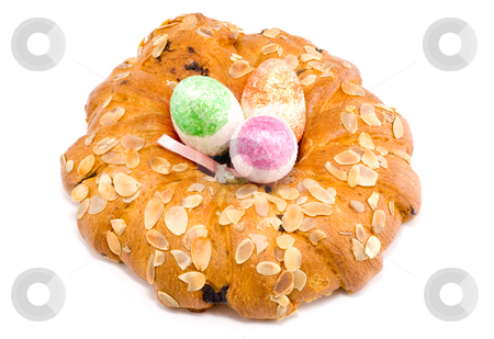 Easter Wreath with Easter Eggs stock photo, Easter pastry wreath with three colourful easter eggs in it by Petr Koudelka