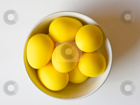 Easter yellow eggs in a bowl stock photo, Fake yellow eggs in a bowl view from above. by FEL Yannick