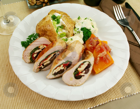 Stuffed Chicken stock photo, Chicken stuffed with a Mediterranean filling made of spinach, fetta, peppers and olives with vegetables. by Brett Mulcahy