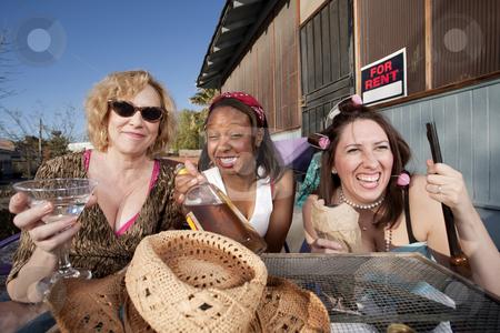 Three women drinking alcohol stock photo, Three women outside a house drinking alcoholic beverages by Scott Griessel