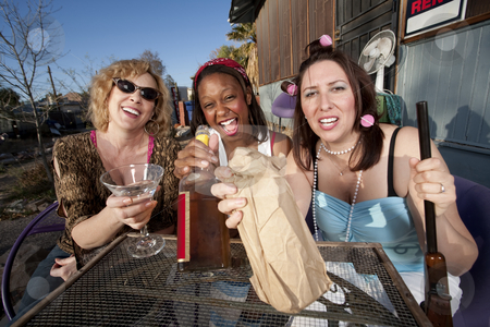 Three women drinking alcohol stock photo, Three women outside a house drinking alcoholic beverages by Scott Griessel