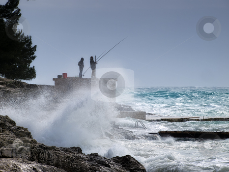 FIshing storm stock photo, Silhouette of fishermen surrounded by stormy Adriatic Sea by Sinisa Botas