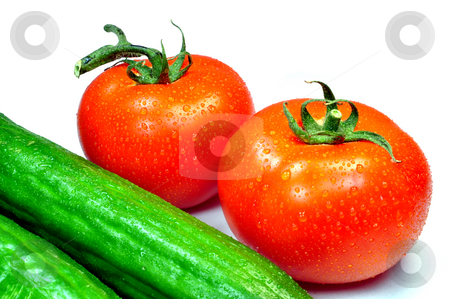 Tomatoes and cucumbers stock photo, Fresh vegetables, tomatoes and cucumbers by Fernando Barozza