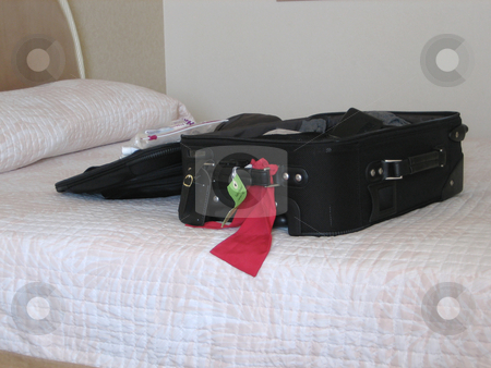 The traveler stock photo, Pictures of a suitcase on the bed inside a hotel room by Albert Lozano