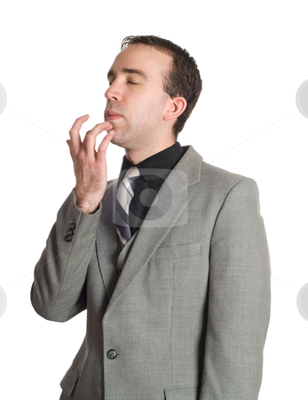 Emotional Freedom Technique stock photo, Closeup view of a businessman tapping his chin as a step in performing the Emotional Freedom Technique, isolated against a white background by Richard Nelson