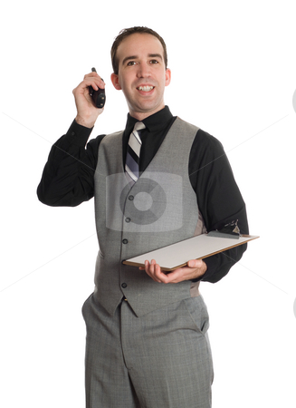 Manager Holding Radio stock photo, A young man wearing a suit and communicating on a walkie-talkie and holding a clipboard, isolated against a white background by Richard Nelson