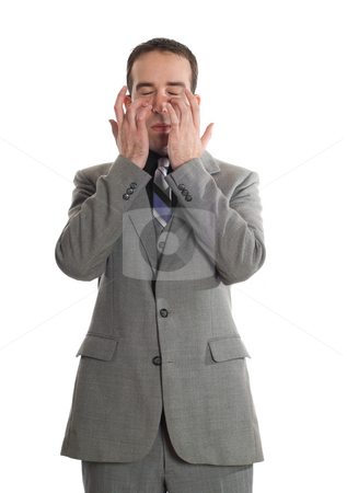 Emotional Freedom Technique stock photo, Front view of a businessman tapping under his eyes as a step in performing the Emotional Freedom Technique, isolated against a white background by Richard Nelson